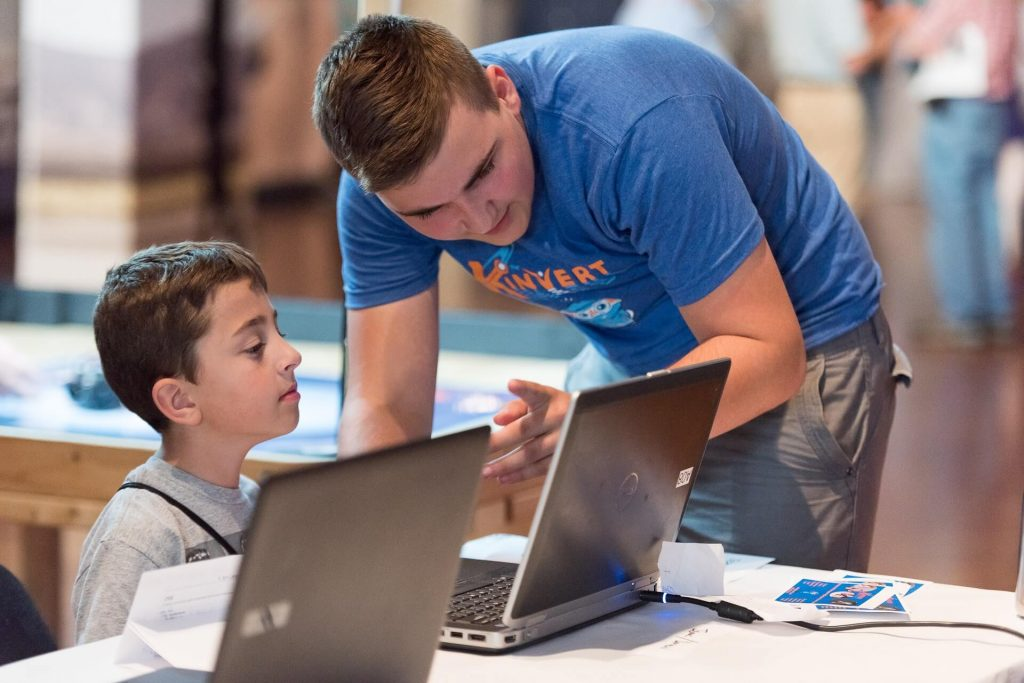 Students made their own video games for Maker Faire Detroit and taught kids how to learn these skills