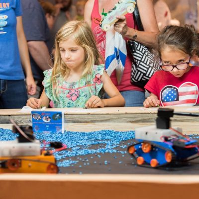 STEM girls focused on driving construction robots made in 3D Printing Robotics and Coding Class