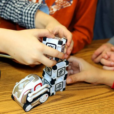 Kids have fun with Cozmo education using teamwork, problem solving, and critical thinking in our STEM Camps for Kids