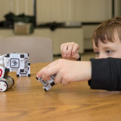 As part of our Anki Cozmo Robotics Competition Summer Camp for Kids and Teens a student interacts with Cozmo