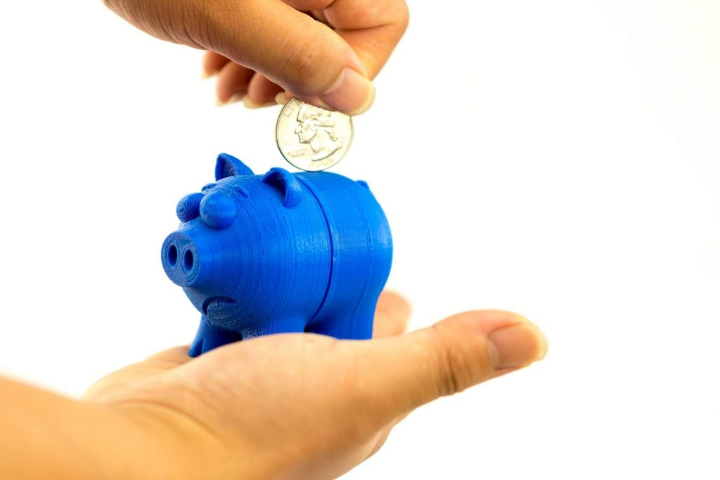 Busness for Kids - Beyond a Lemonade Stand - Class for kids image shows a piggy bank with coin being put in
