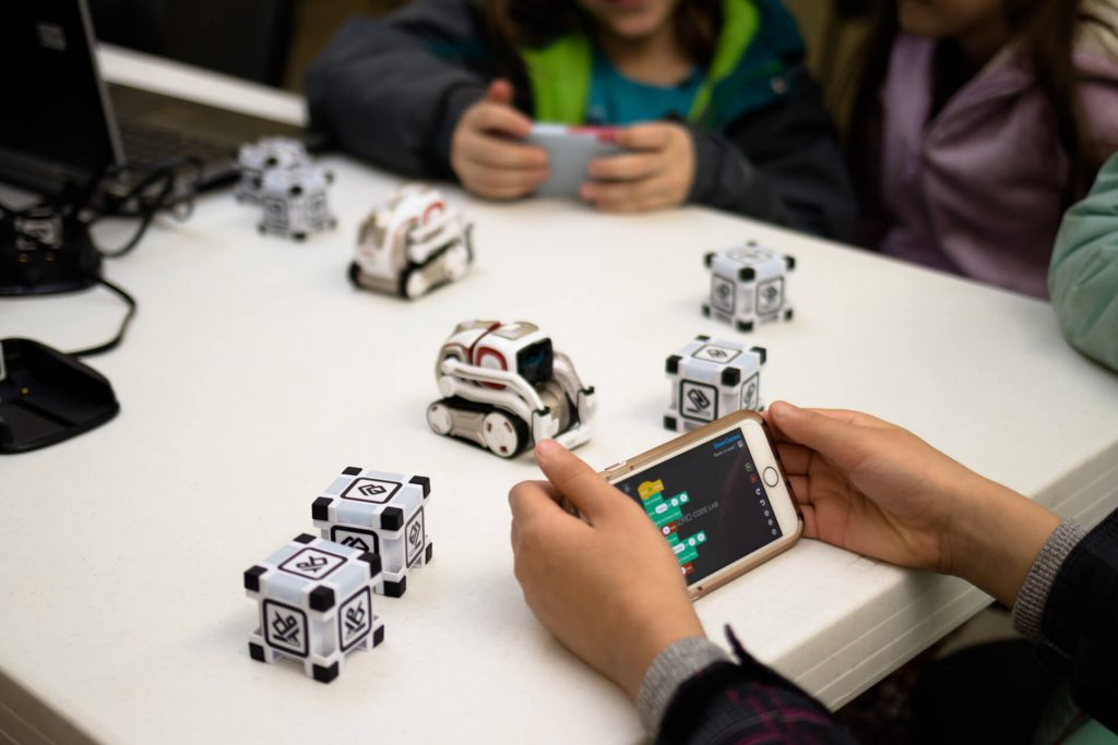 girls block coding Cozmo with Code Lab in Kinvert Robotics for Kids class